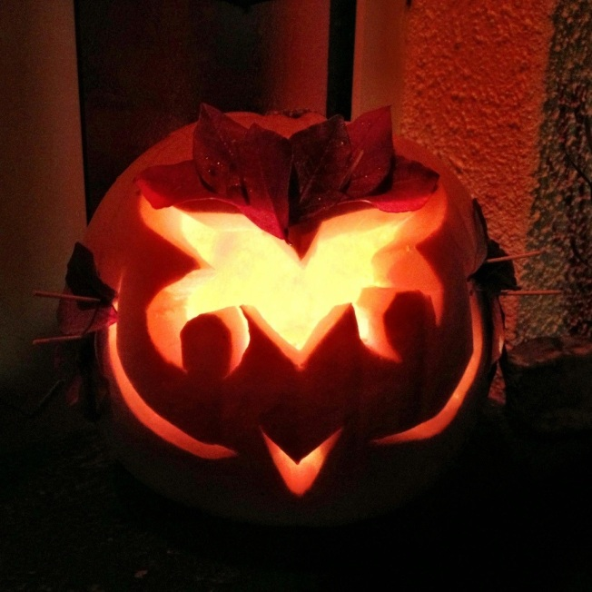 owl pumpkin with leaf feathers.jpg